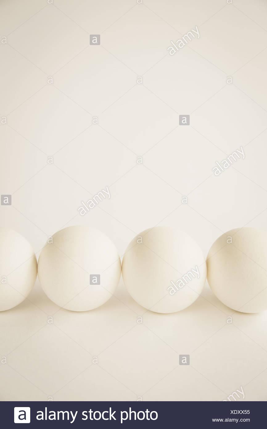 End-on view free range organic eggs white shells - Stock Image