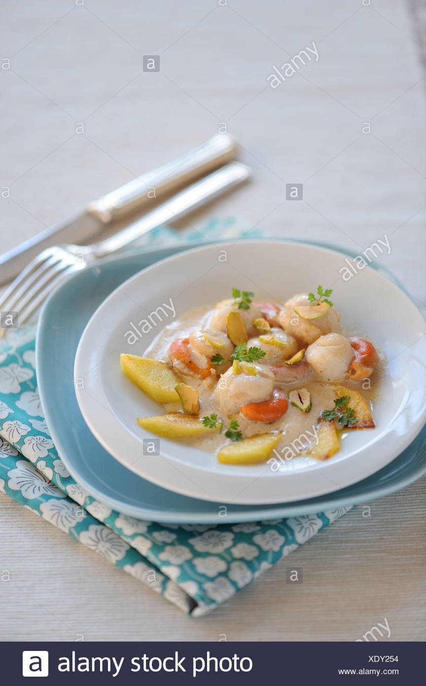 Scallops with Apple and Pistachio - Stock Image