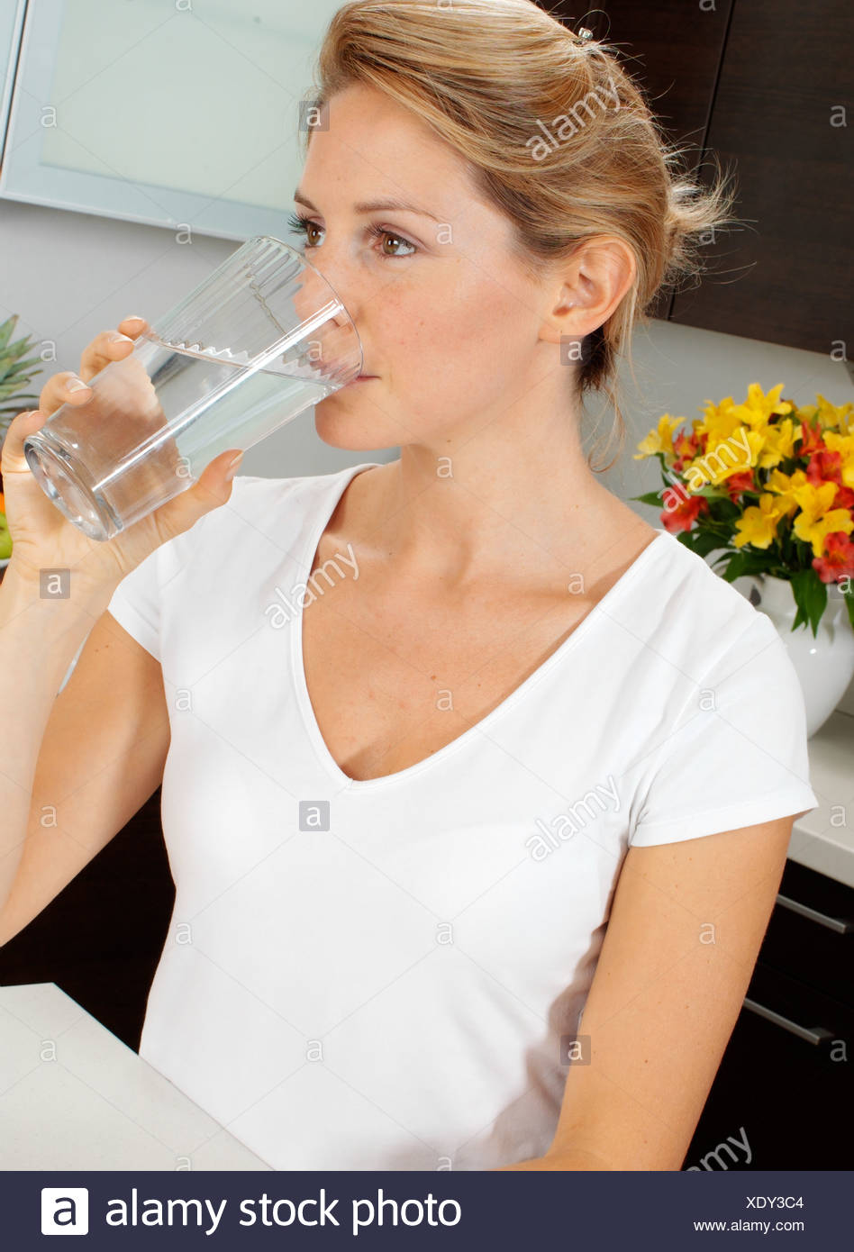 WOMAN DRINKING GLASS OF WATER - Stock Image