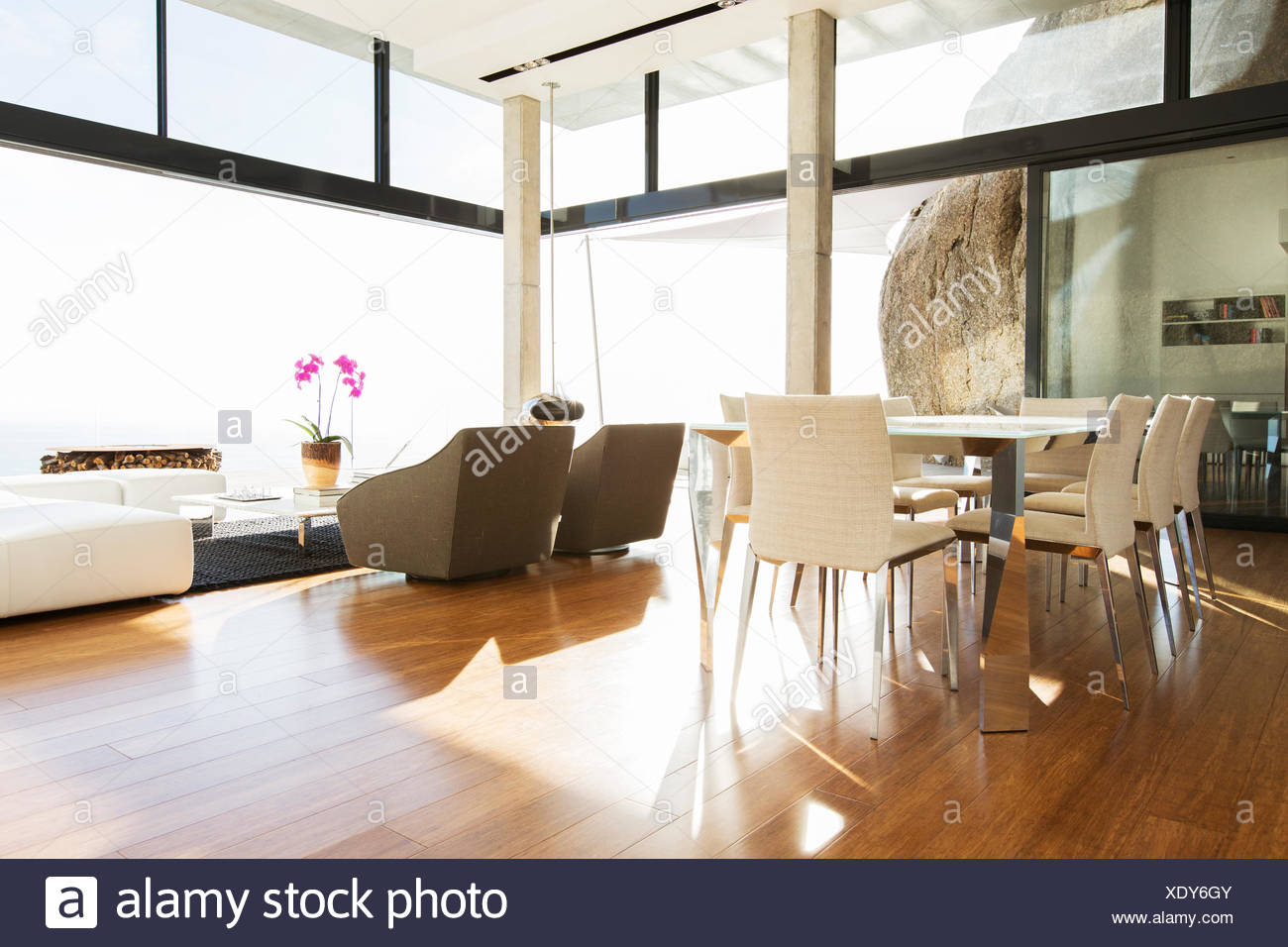 Dining and living area in modern house - Stock Image