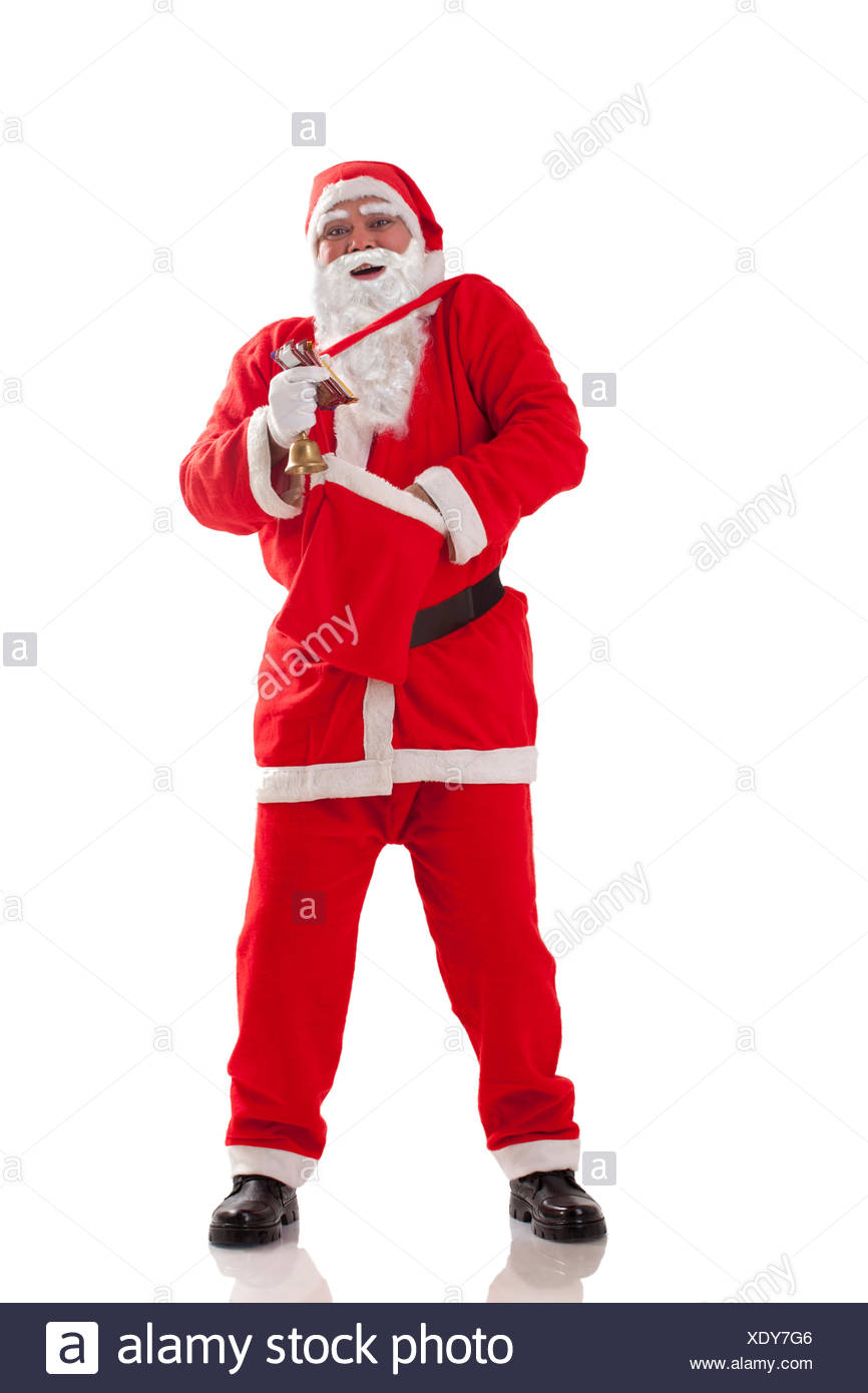 Front view of Santa Claus removing something from bag - Stock Image