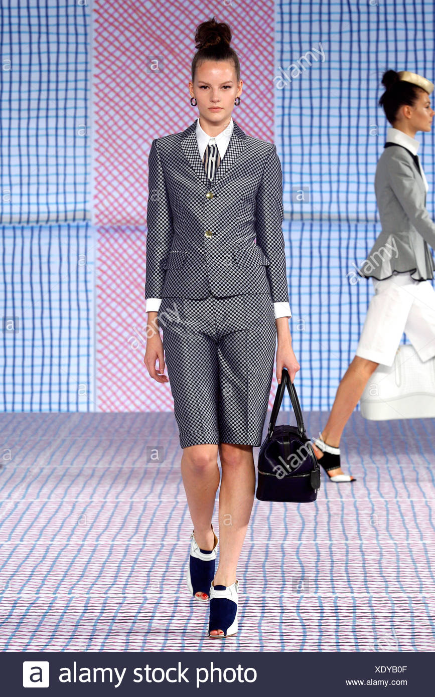 Pollini Milan Ready to Wear Spring Summer Monochrome polkadot shorts suit with black handbag and peep toe shoe boots - Stock Image