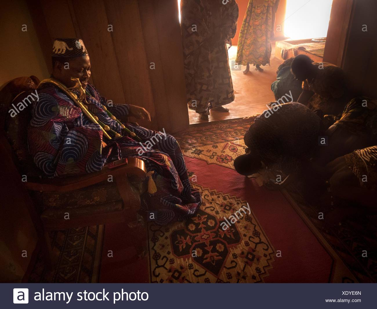 Servants prostrate themselves before the King of Agonlin. - Stock Image