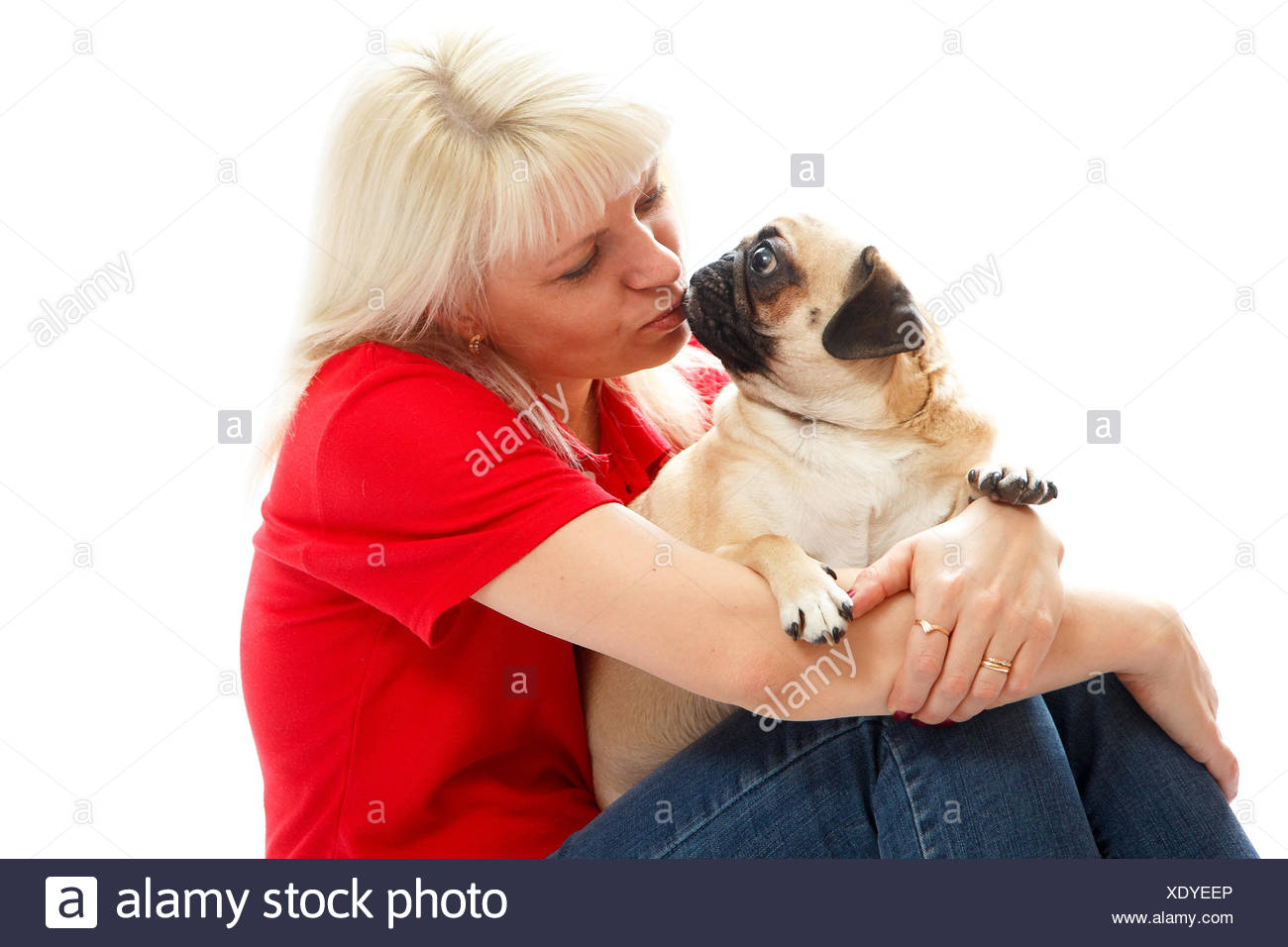 oman kissing a pug Stock Photo