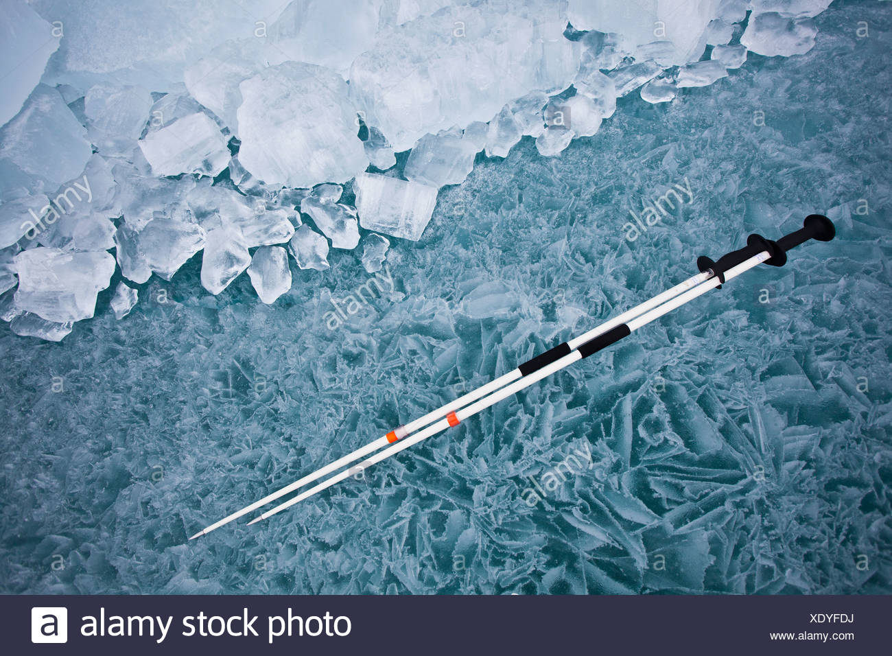 Pair of ski poles on ice rink - Stock Image