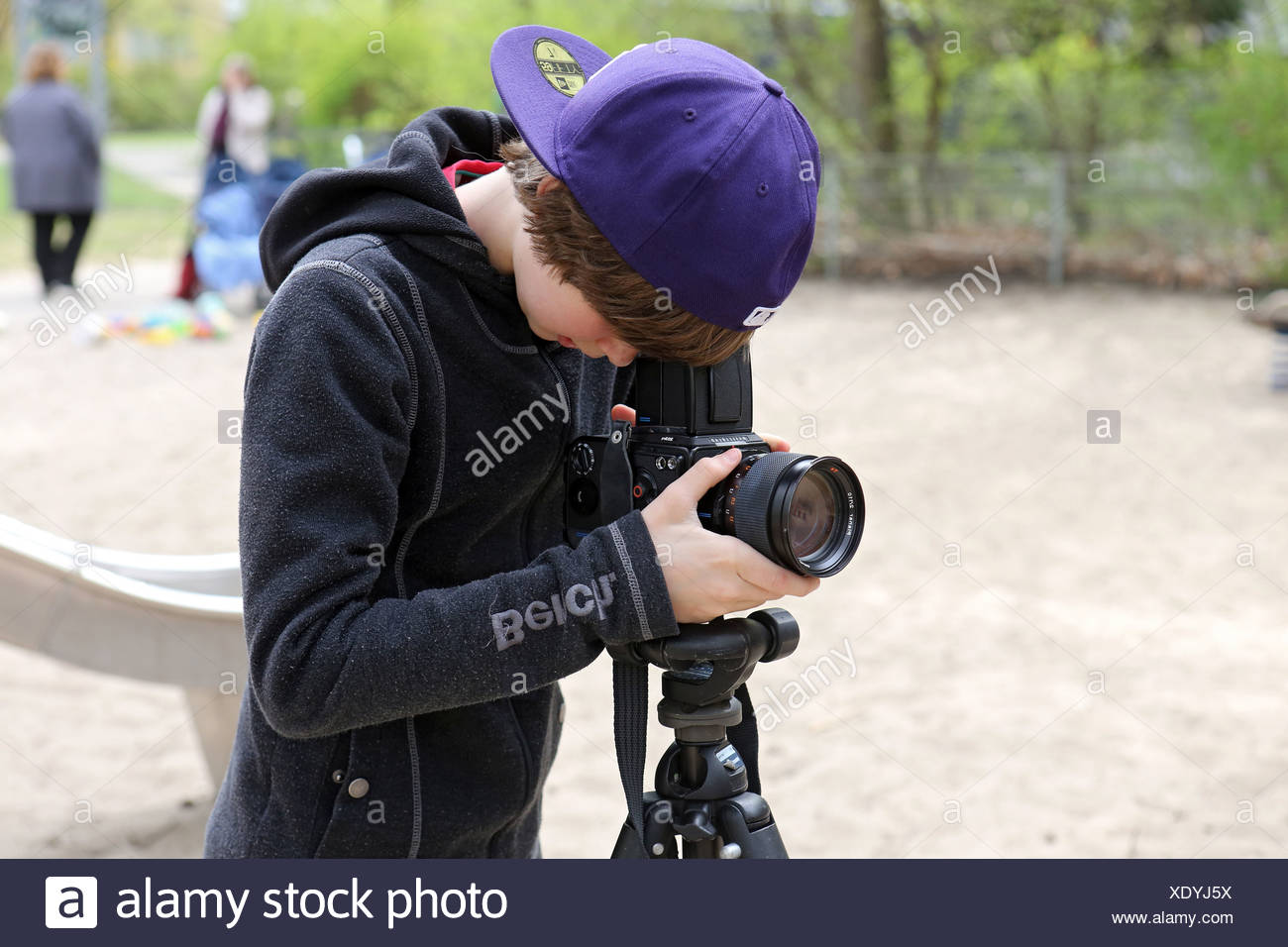 Berlin, Germany, boy photographed with a Hasselblad medium format camera - Stock Image