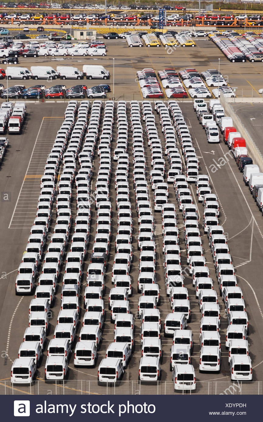 Top view of unloaded new motor vehicles in the port of Civitavecchia, Lazio region, Rome province, Italy, Europe - Stock Image