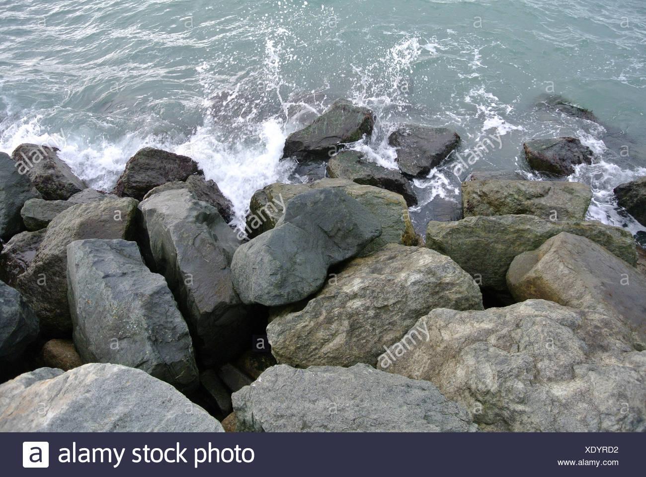 Sea Waves Smashing Against Boulders - Stock Image