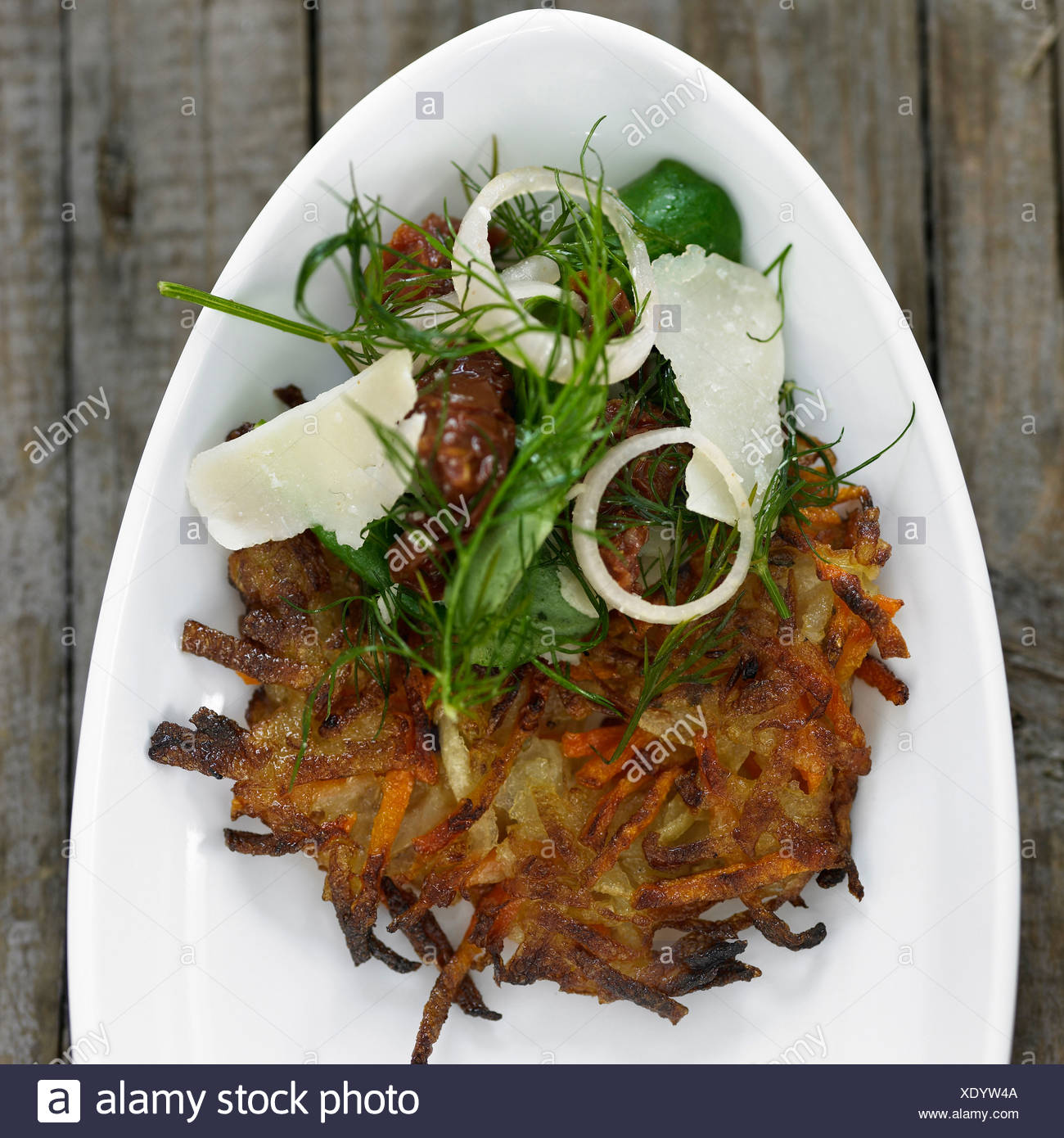 Plate of potato pancake with toppings Stock Photo