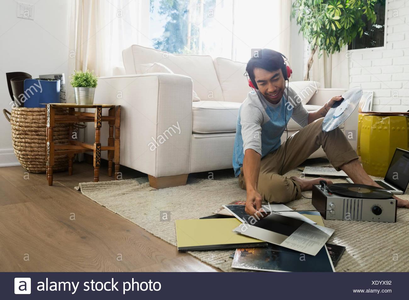 Man With Headphones Listening Vinyl Records Living Room