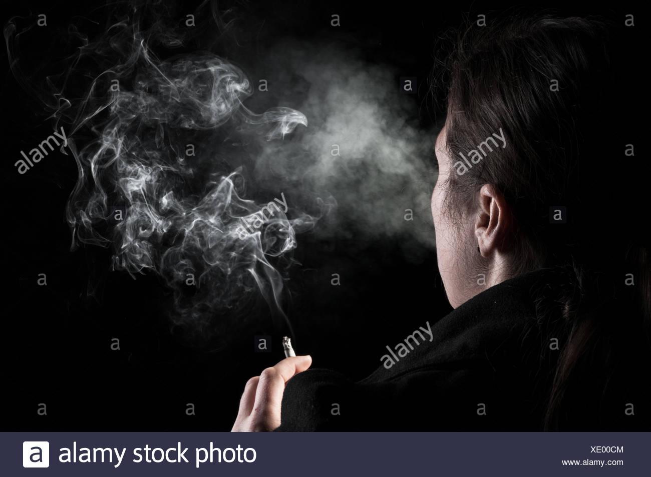 smoking woman - Stock Image