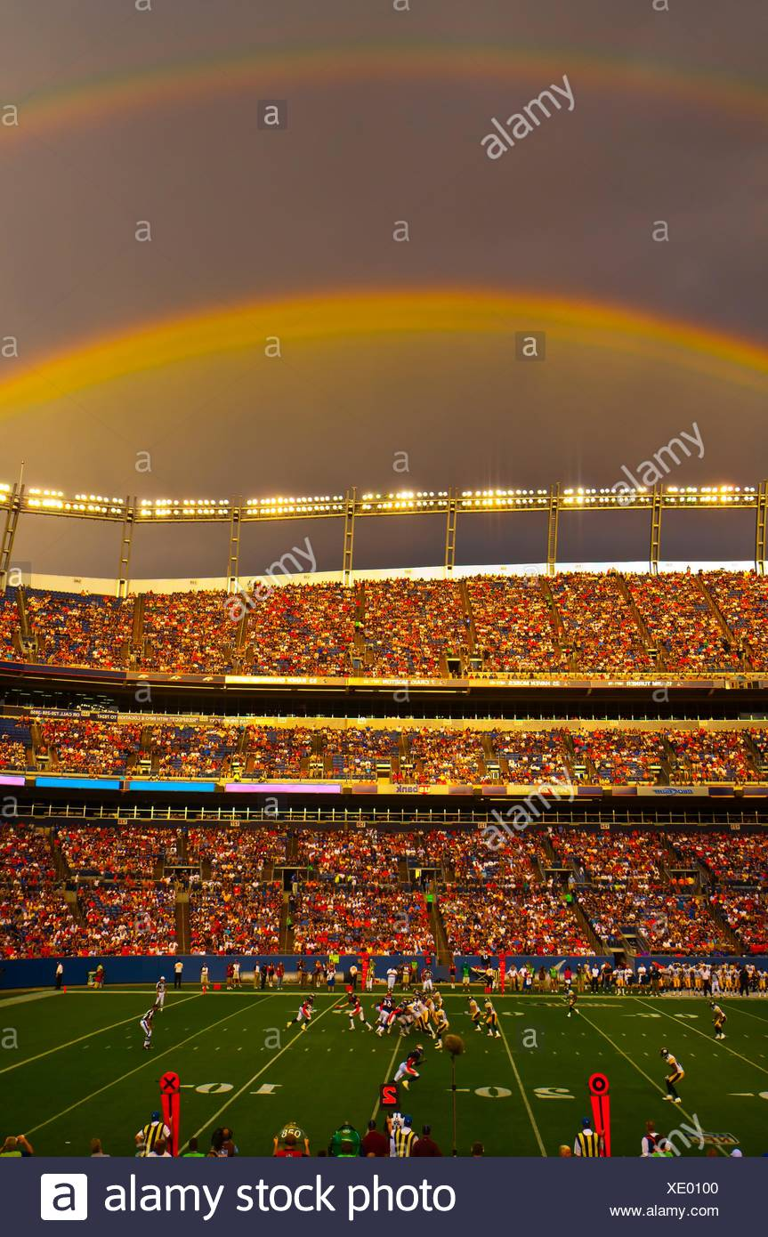 A rainbow over the stadium, Denver Broncos vs. Pittsburgh Steelers NFL football game, Invesco Field at Mile High (stadium), - Stock Image
