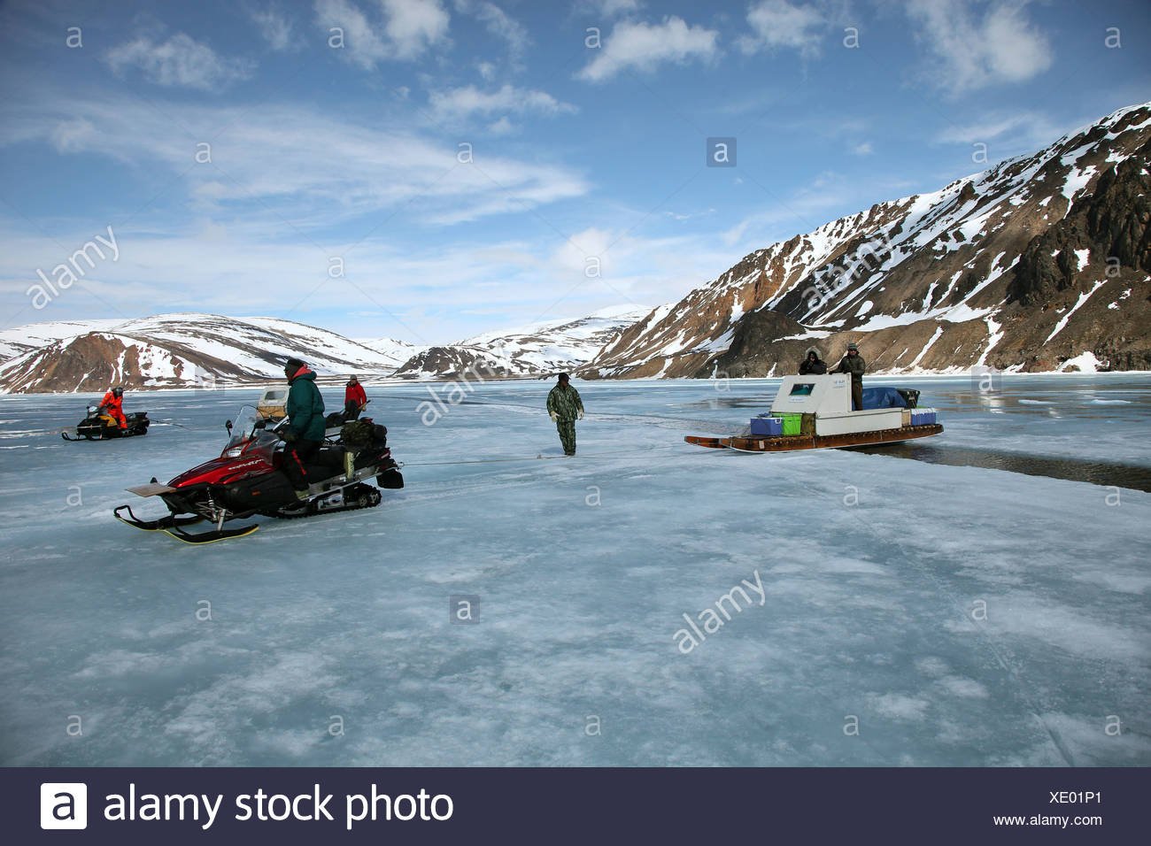 the Qamutik is being pulled over a crack in the ice, Canada, Nunavut - Stock Image