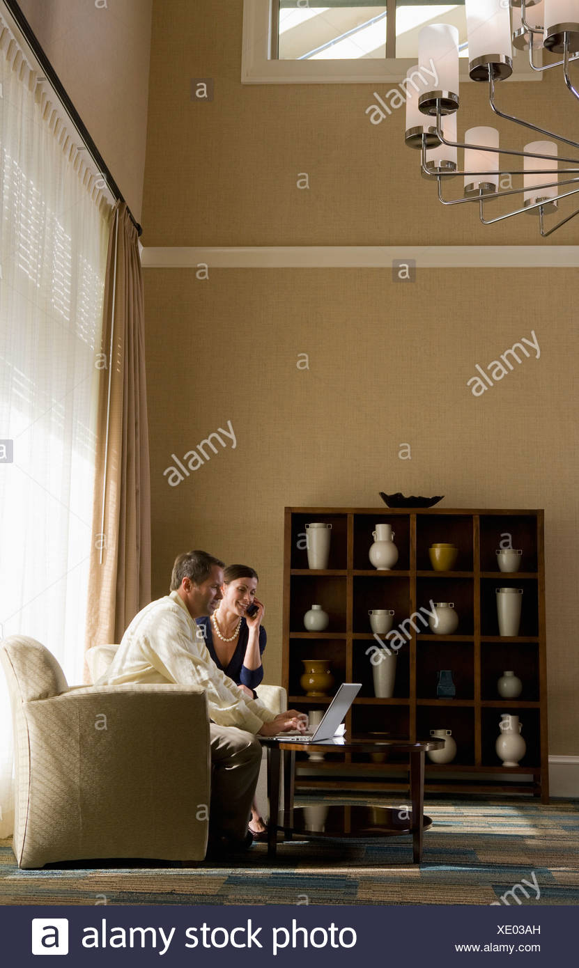 Two business people in a lobby Stock Photo