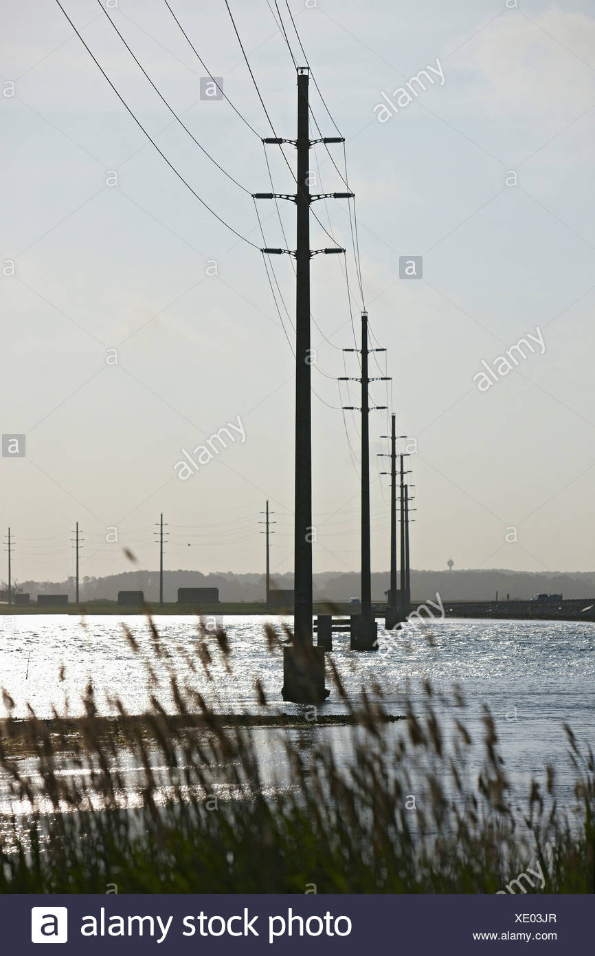 Power Lines Spanning Chincoteague Bay - Stock Image