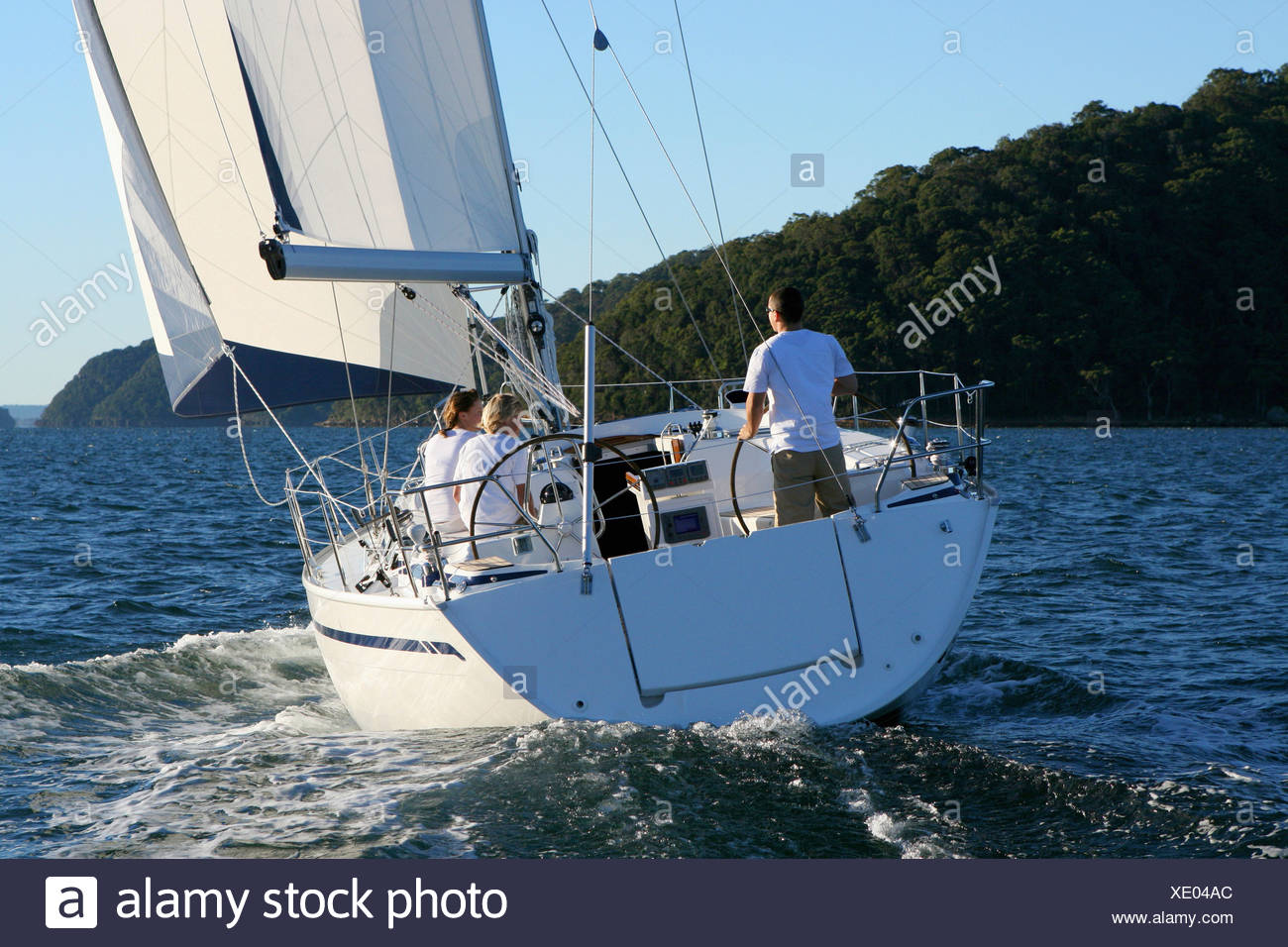 A yacht cruising on the North Shore from Sydney, Australia. - Stock Image