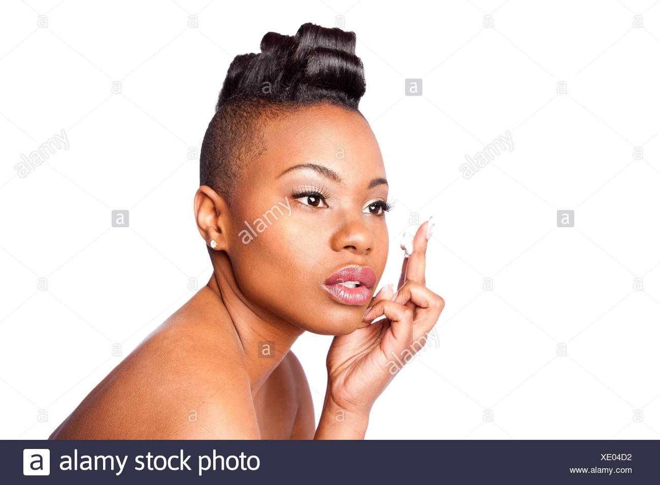 Face of beautiful woman applying facial moisturizer exfoliating anti wrinkle aging cream under eyes, skincare concept, isolated. - Stock Image