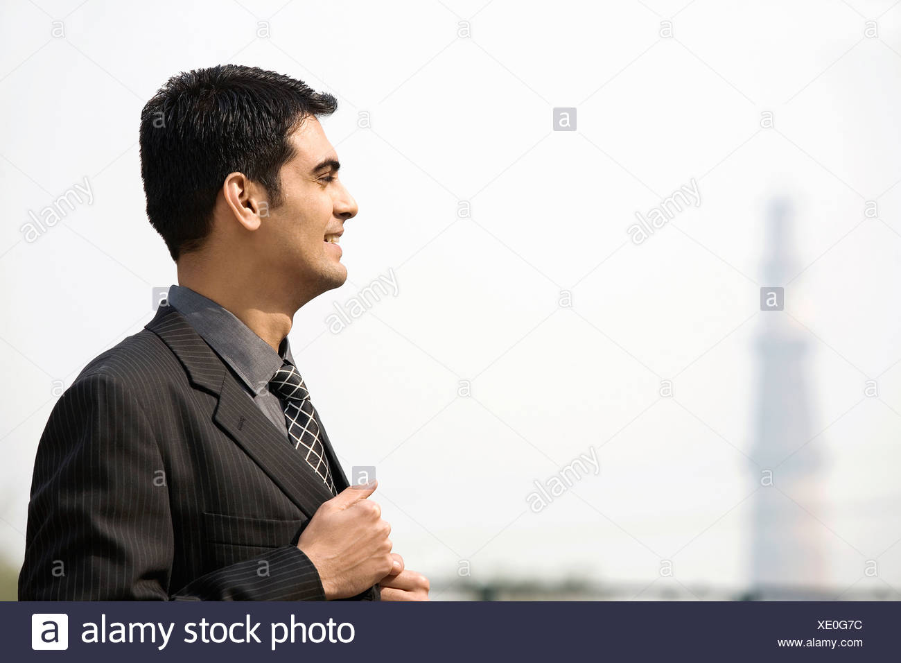 Businessman smiling - Stock Image