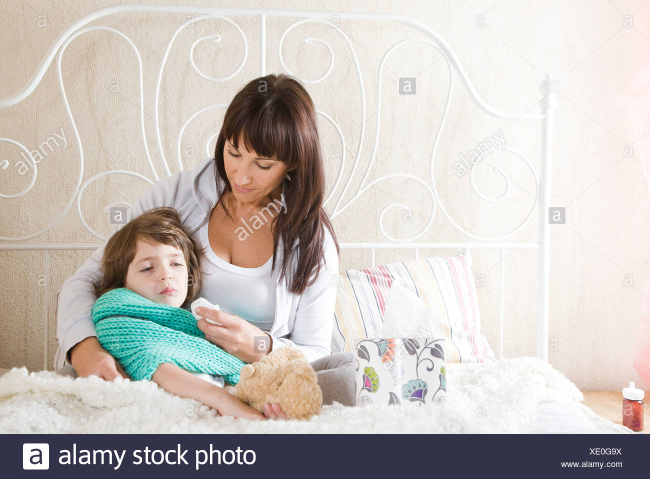 Mother taking care of sick daughter - Stock Image