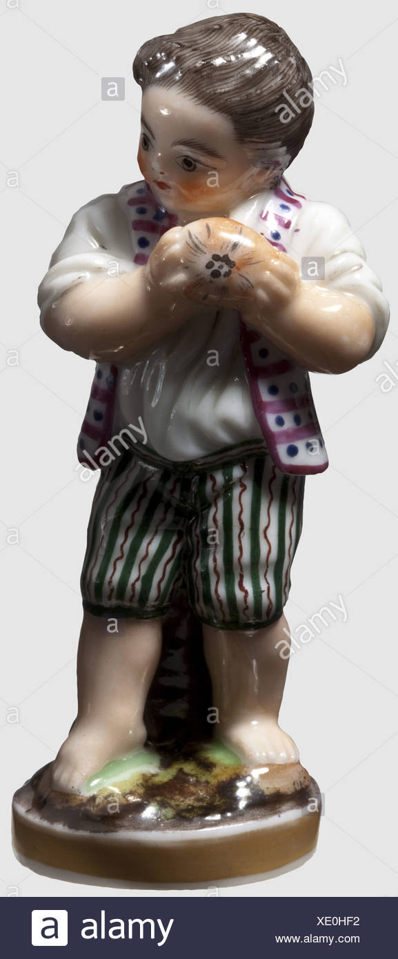 A boy's figure with Easter egg, Russian private manufactory, mid-19th century. Porcelain, glazed and finely painted by hand, a restored hairline crack at the hip, except for that in beautiful condition. Height 8.7 cm. Extremely rare figure, historic, historical, people, 19th century, object, objects, stills, clipping, clippings, cut out, cut-out, cut-outs, Additional-Rights-Clearences-NA - Stock Image