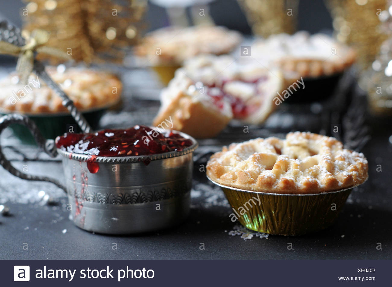 Small pastry filled with raspberry jam - Stock Image