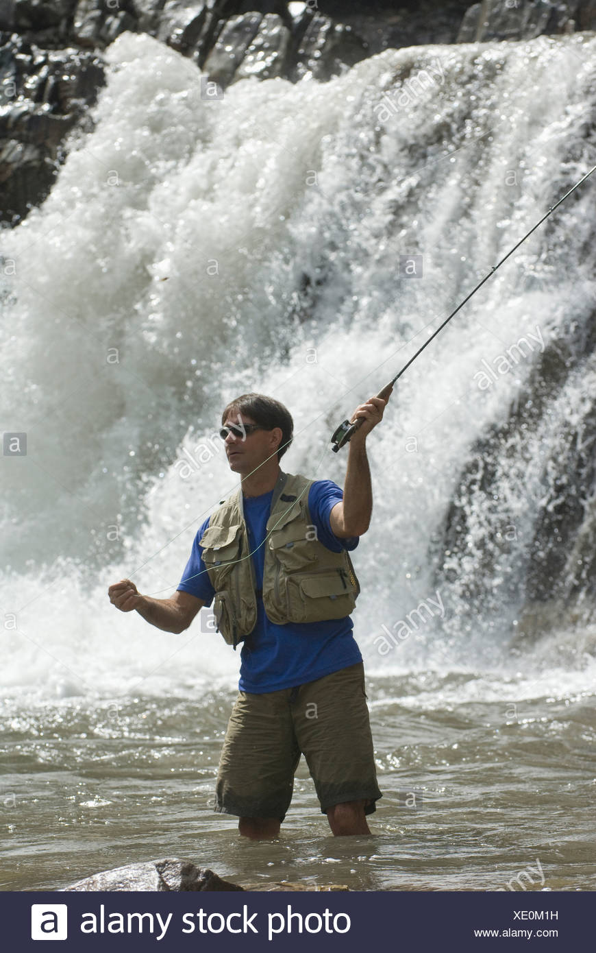 Man fly fishing below Crystal Falls, Marble, Colorado. - Stock Image