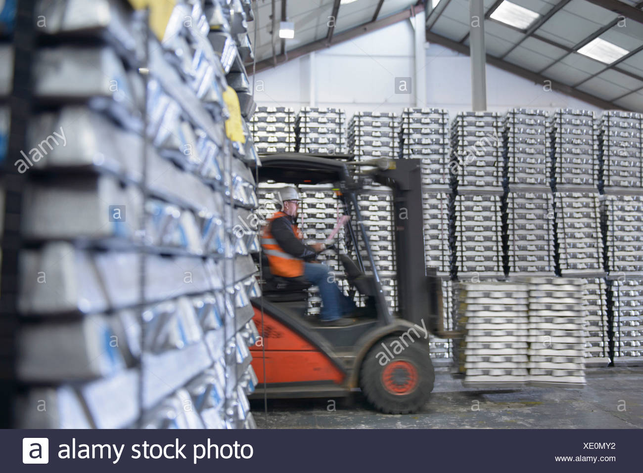 Forklift truck moving stock in warehouse - Stock Image
