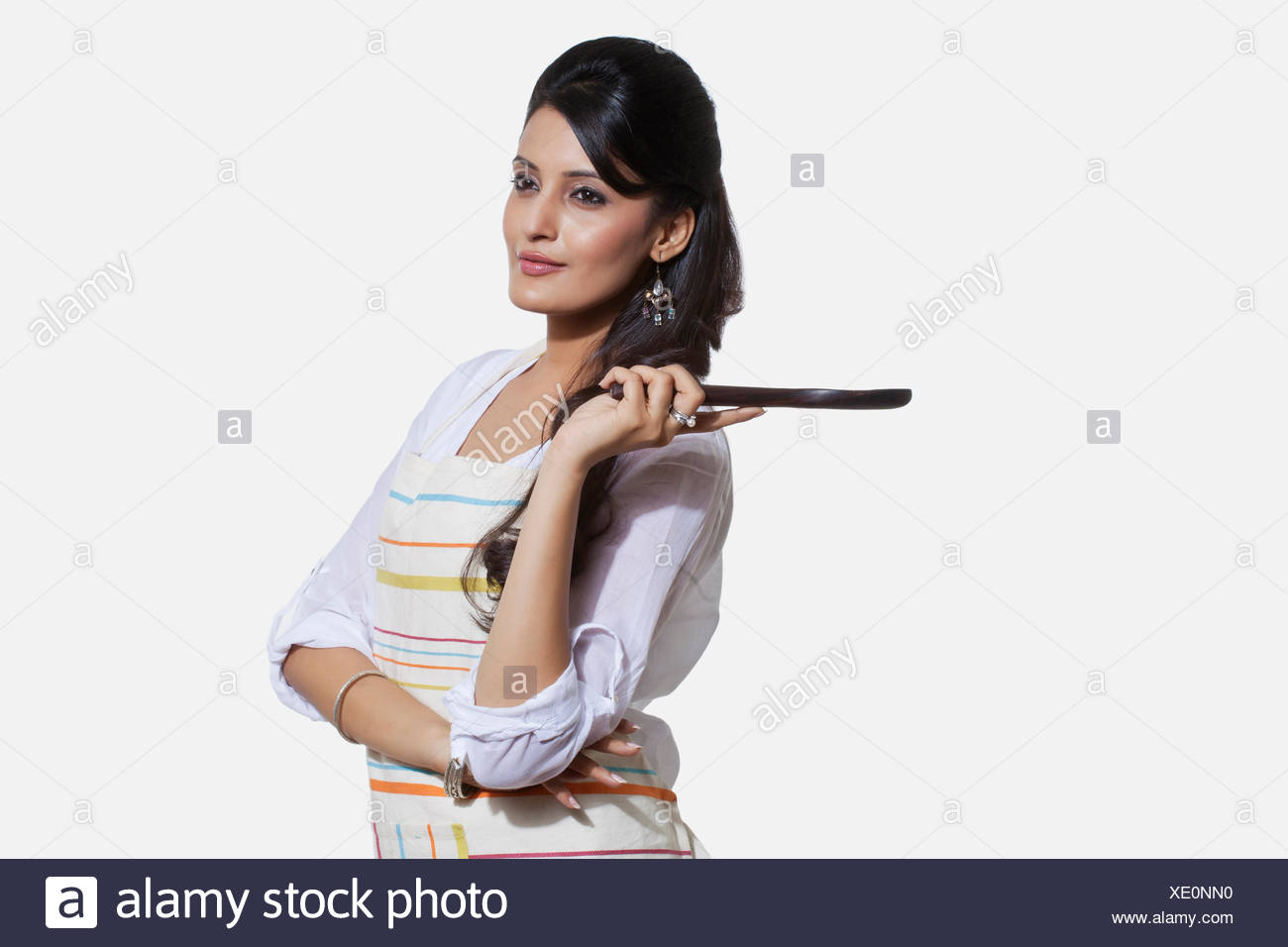 Woman with a cooking utensil - Stock Image