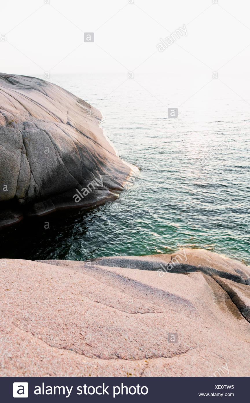 Flat rock at the ocean - Stock Image