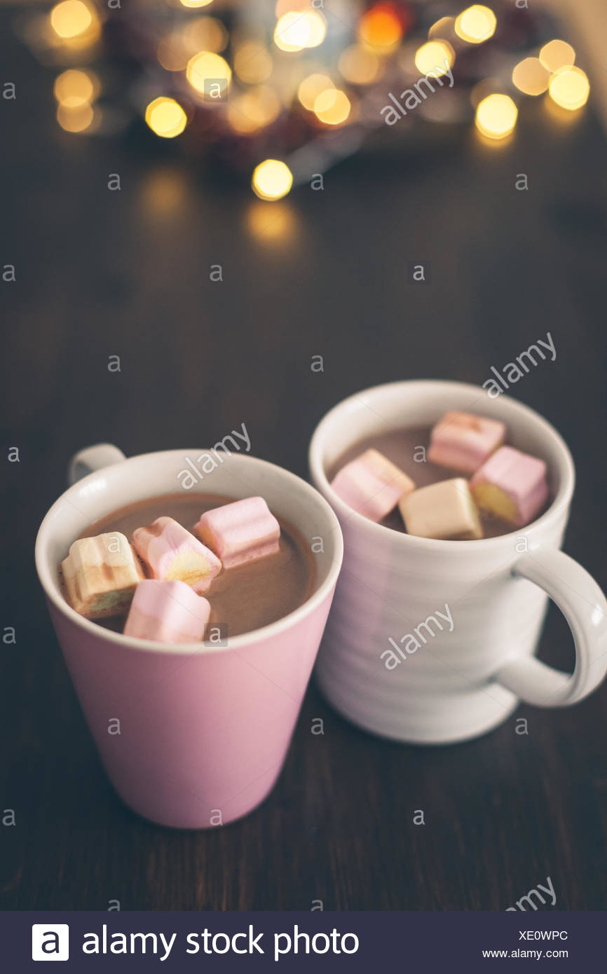 Close-Up Of Hot Chocolate With Marshmallows On Table - Stock Image