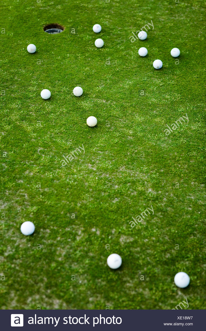 Golf balls on a putting green - Stock Image
