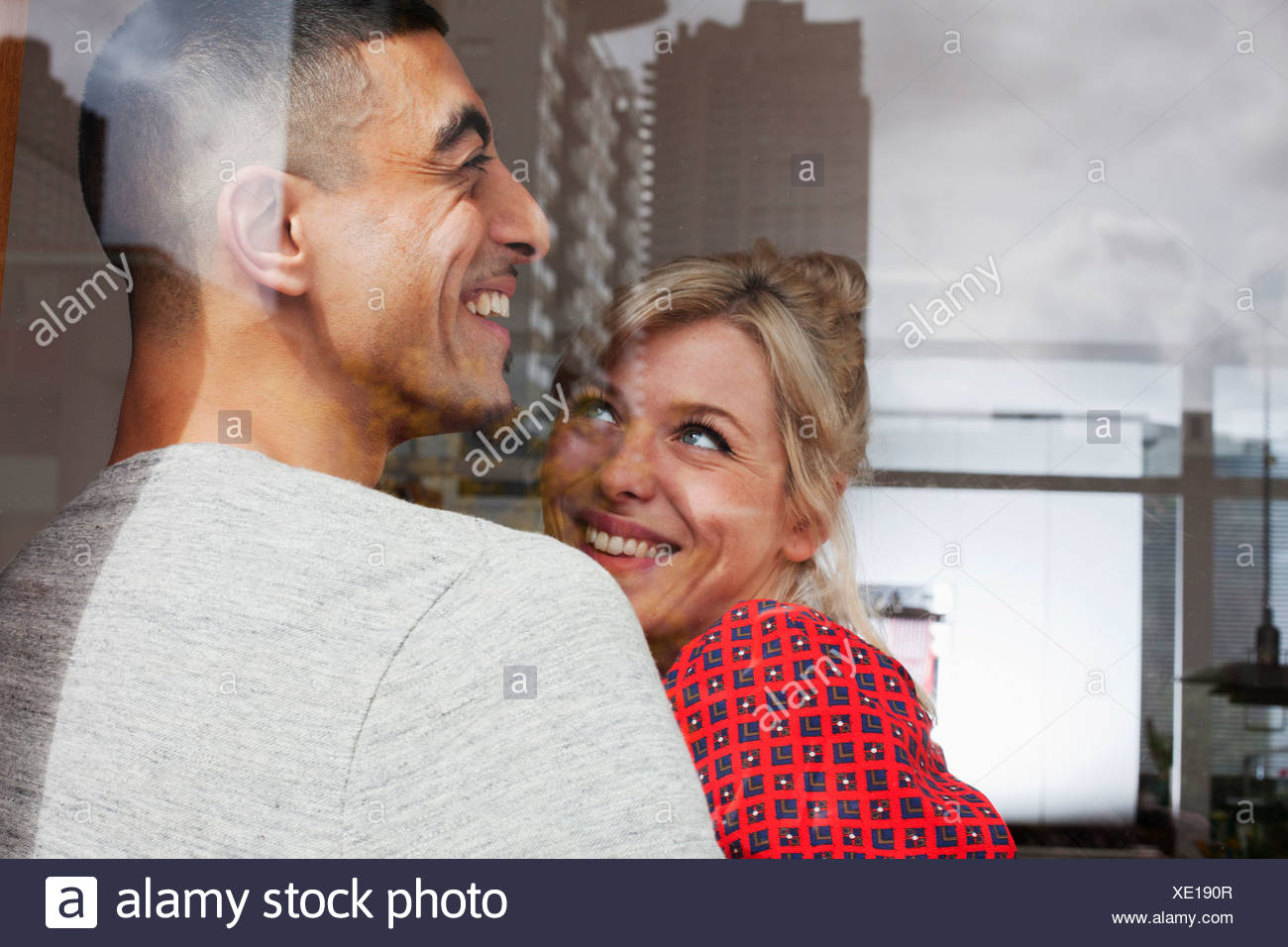Young couple through window Stock Photo