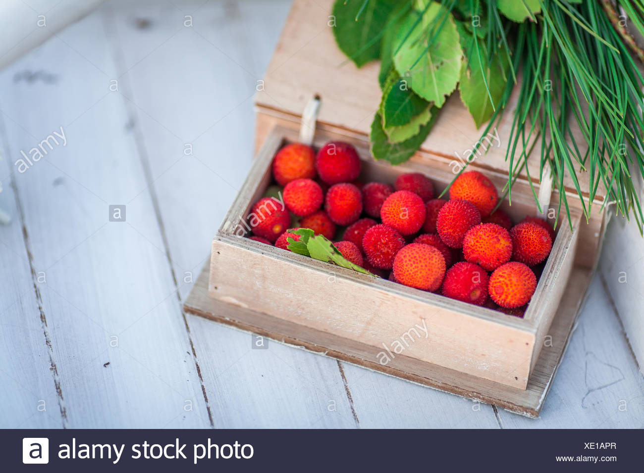 Wooden box of lychee fruit - Stock Image