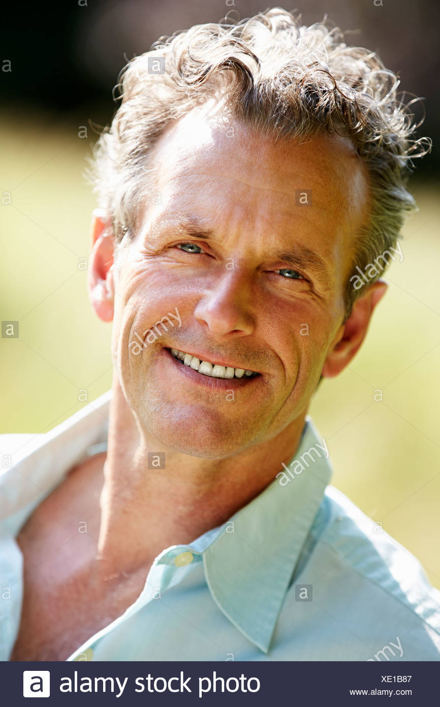 Outdoor Portrait Of Middle Aged Man - Stock Image