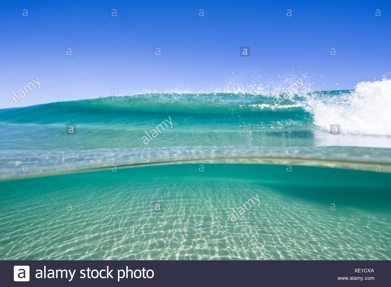 View of waves on sunny day - Stock Image