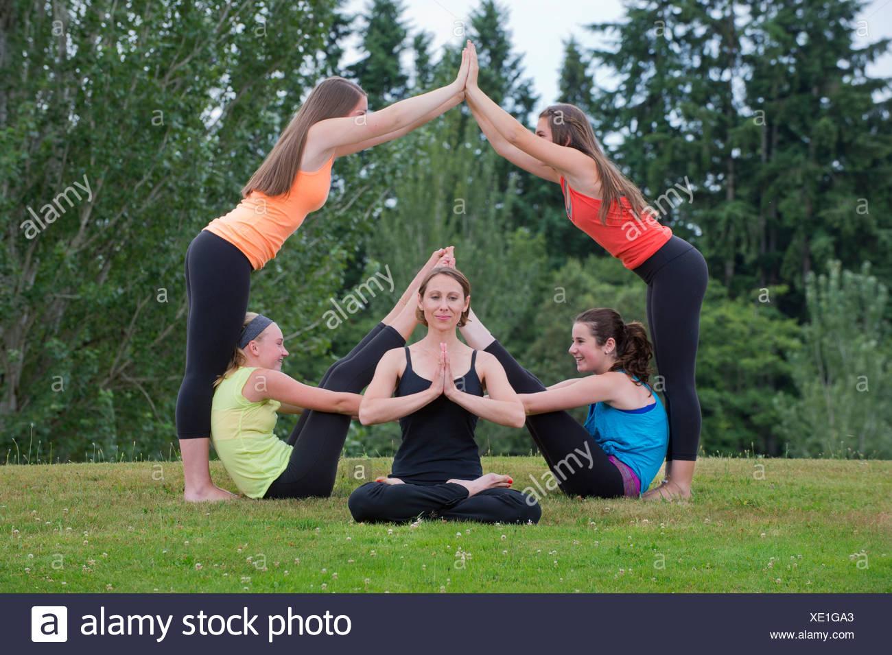 Teenage Girls And Tutor Doing Yoga Stock Photo 284005851 Alamy