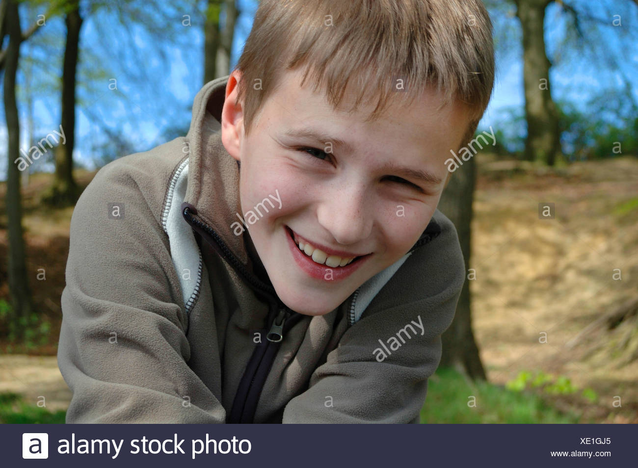 jolly boy in a forest, portrait of a child, Germany - Stock Image
