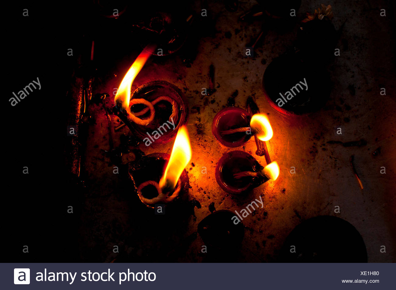 Burning oil lamps in an Indian temple Stock Photo