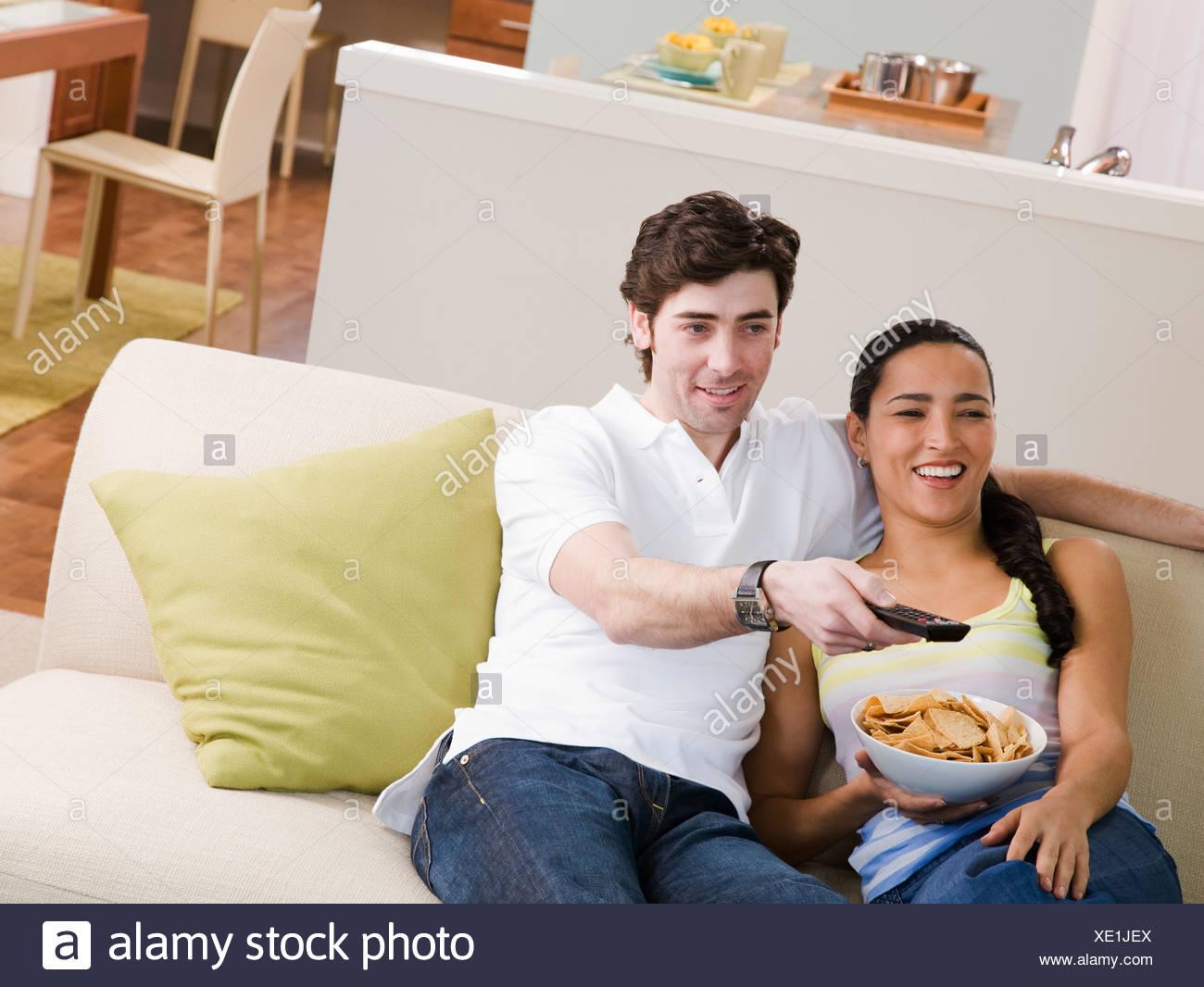 couch potato woman stock photos couch potato woman stock. Black Bedroom Furniture Sets. Home Design Ideas