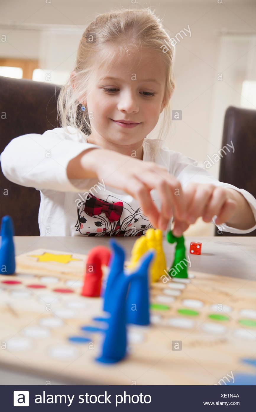 Girl playing board game, Bavaria, Germany Stock Photo