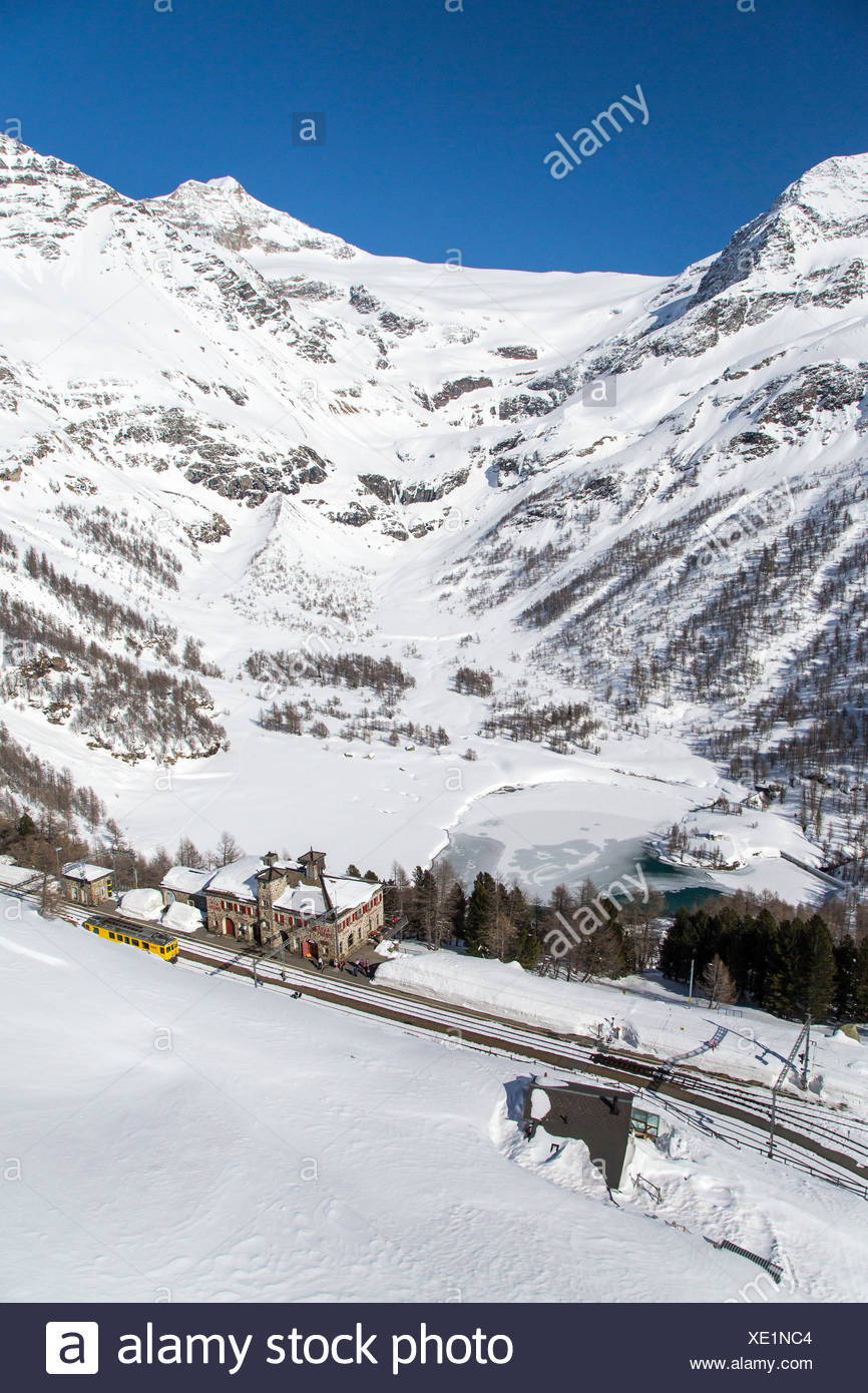 Aerial view of Alp Grum with its artificial basin which begins in Vedret da Palù. Alp Grum, Poschiavo valley, Canton Grigioni, Switzerland. - Stock Image
