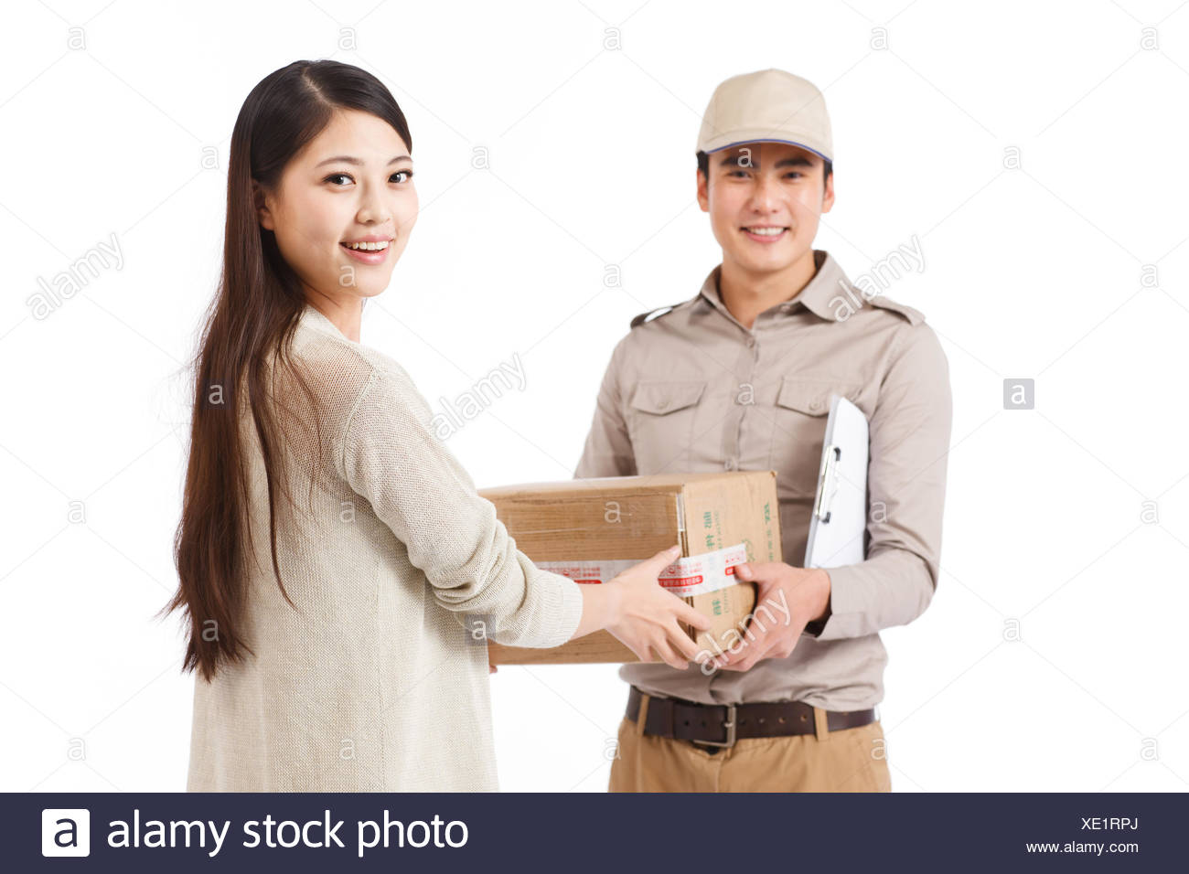 Oriental logistics personnel sent email to customer - Stock Image