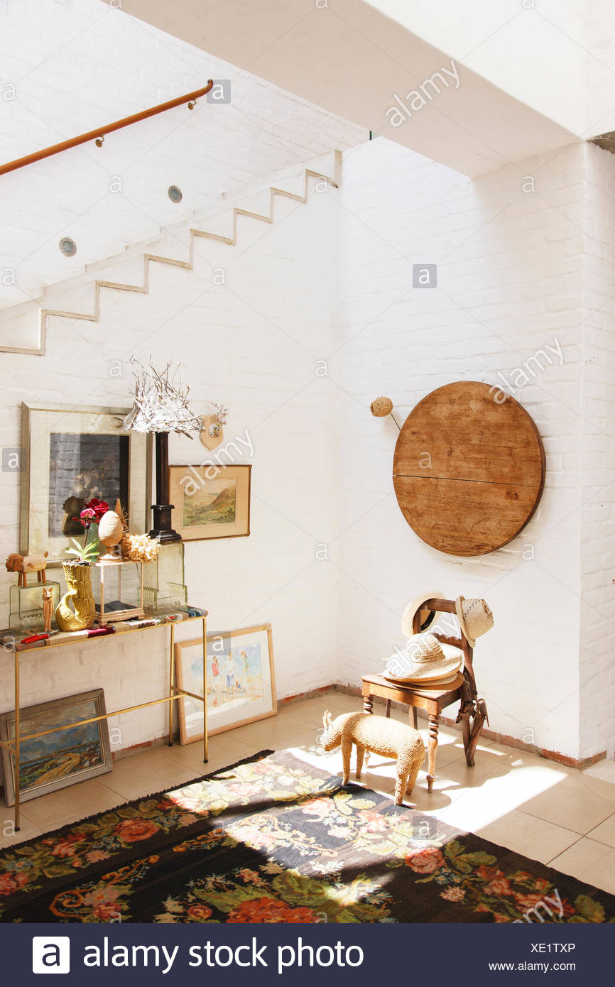 Chair and wall hanging in rustic house - Stock Image