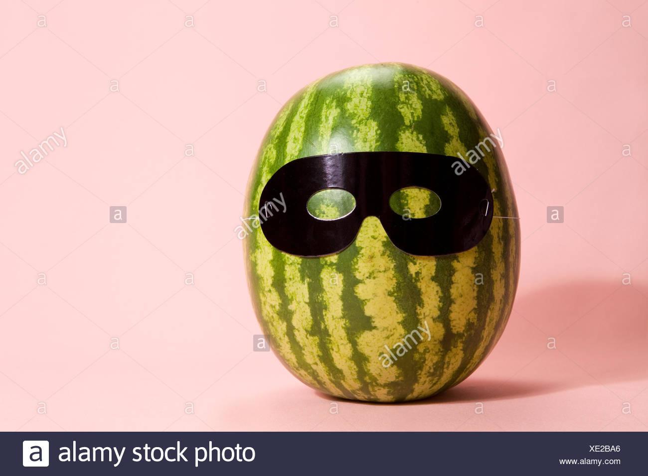 Superwatermelon wearing a black mask - Stock Image