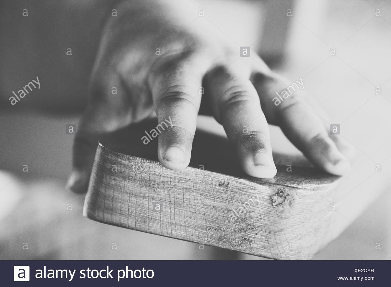 Close-Up Of Baby Girl's Hand - Stock Image