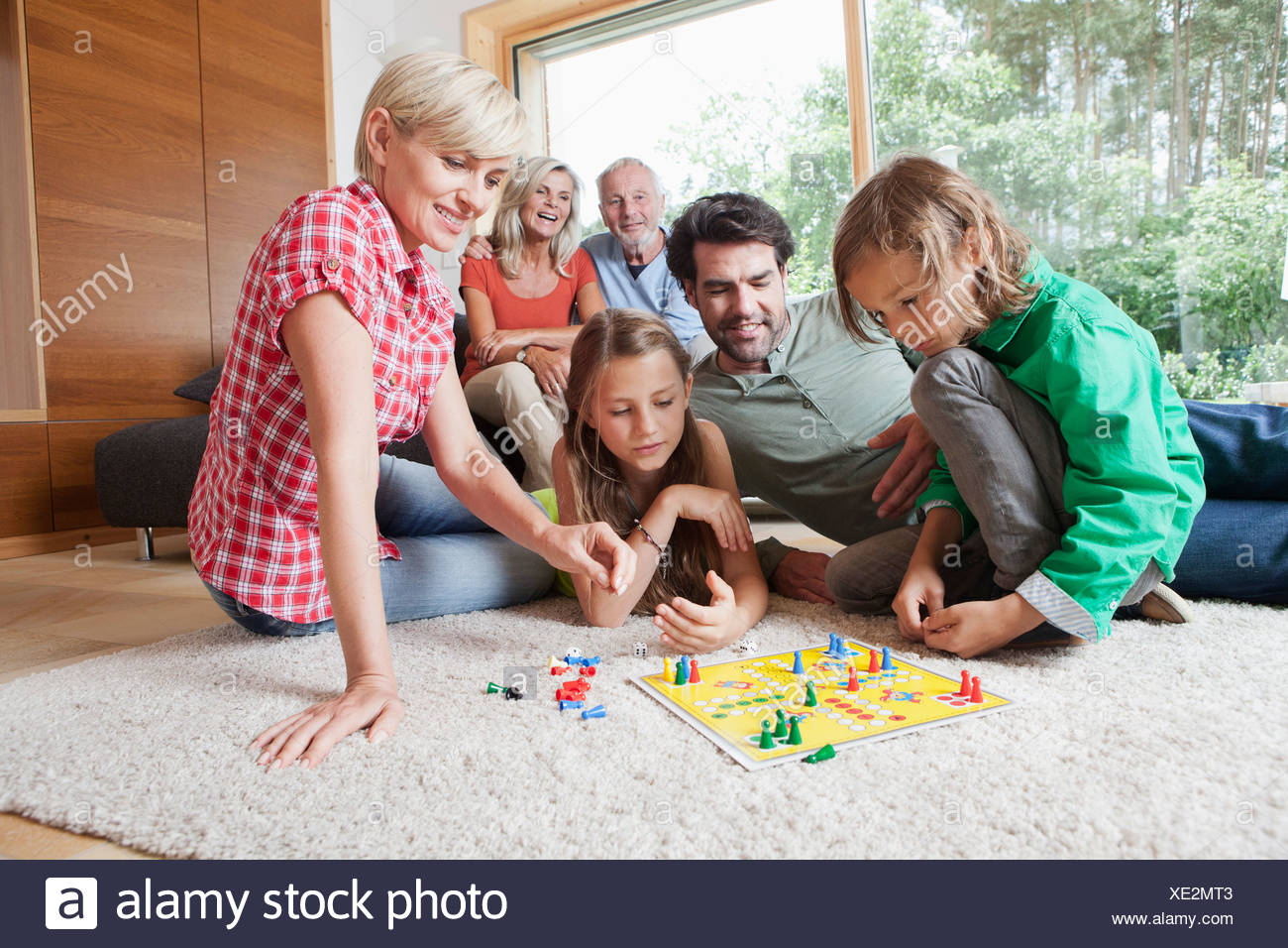 Germany, Bavaria, Nuremberg, Family playing board game together Stock Photo