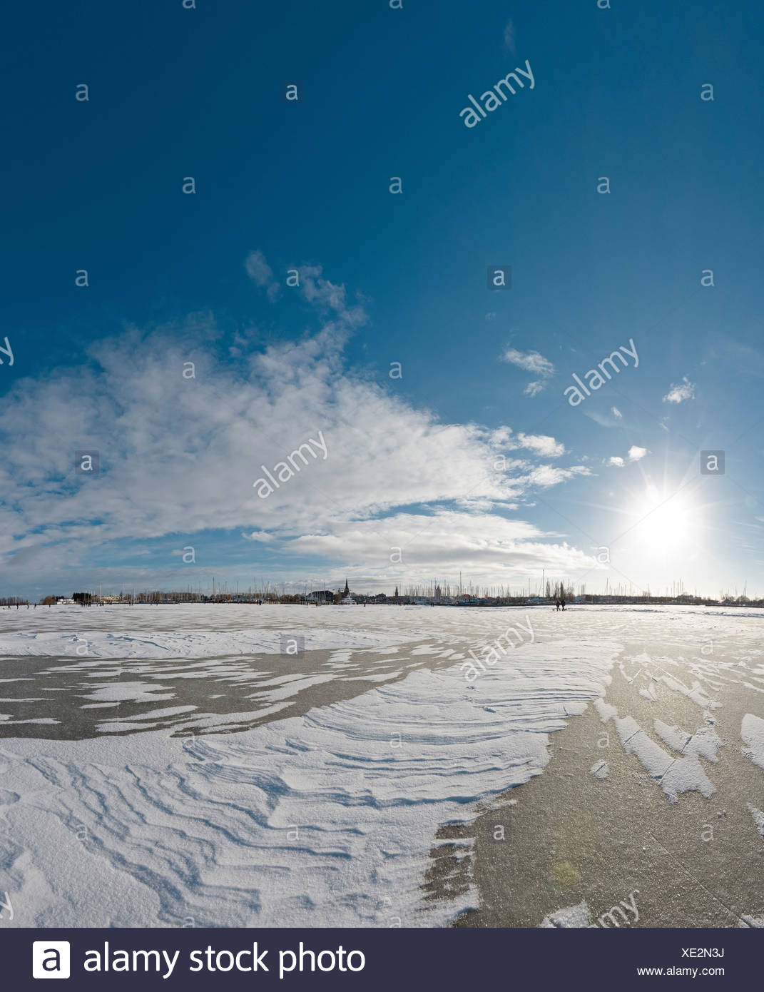 Holland, Netherlands, Europe, Monnickendam, Skaters, frozen, Gouwzee, landscape, water, winter, snow, ice, people, skating, - Stock Image