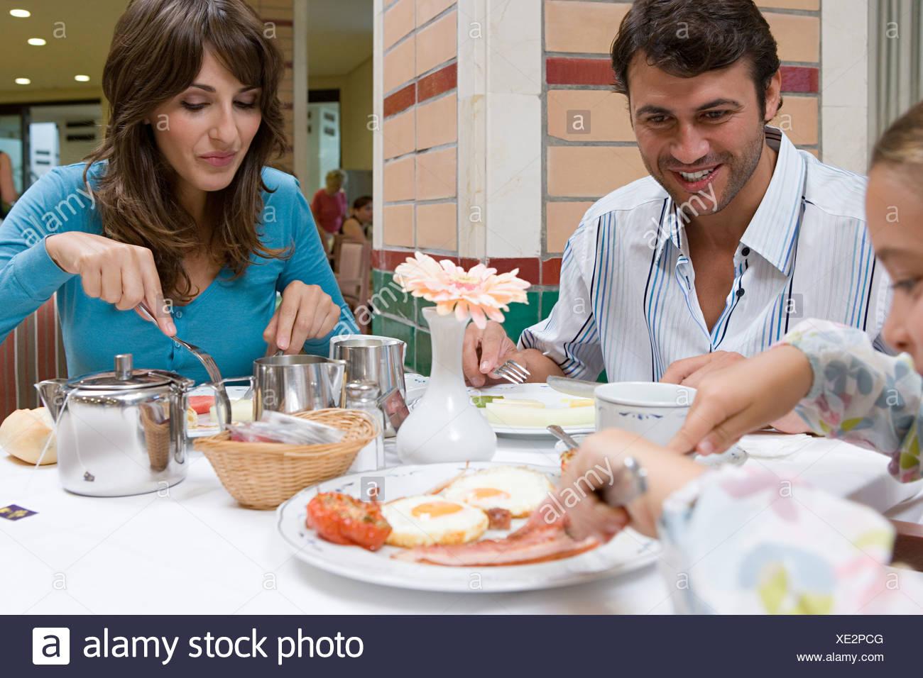 Family eating breakfast - Stock Image