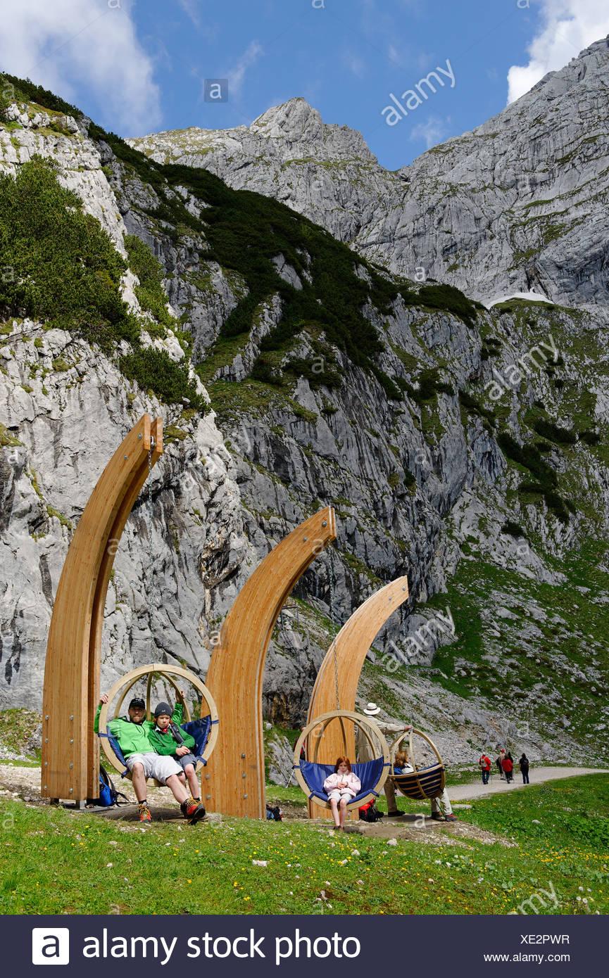 Father and kids on the Gipfel-Erlebnisweg, summit adventure trail at Alpspitzbahn, Garmisch-Partenkirchen, Wetterstein range - Stock Image
