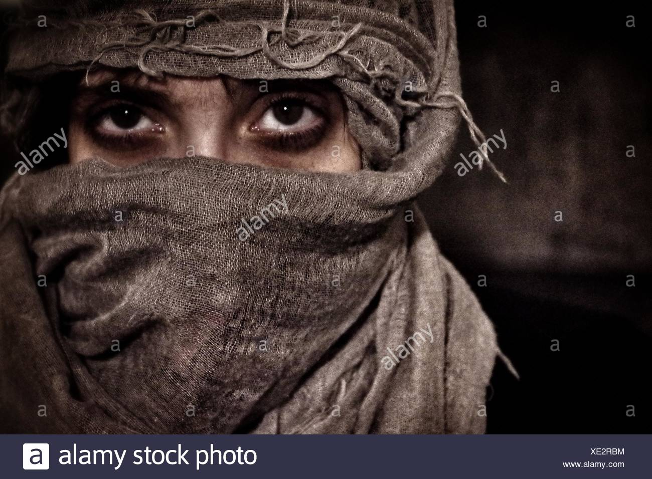 Woman Wearing Headscarf - Stock Image
